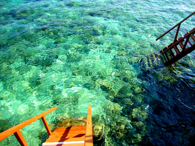 Many Maldives overwater villas feature easy access to the water below.