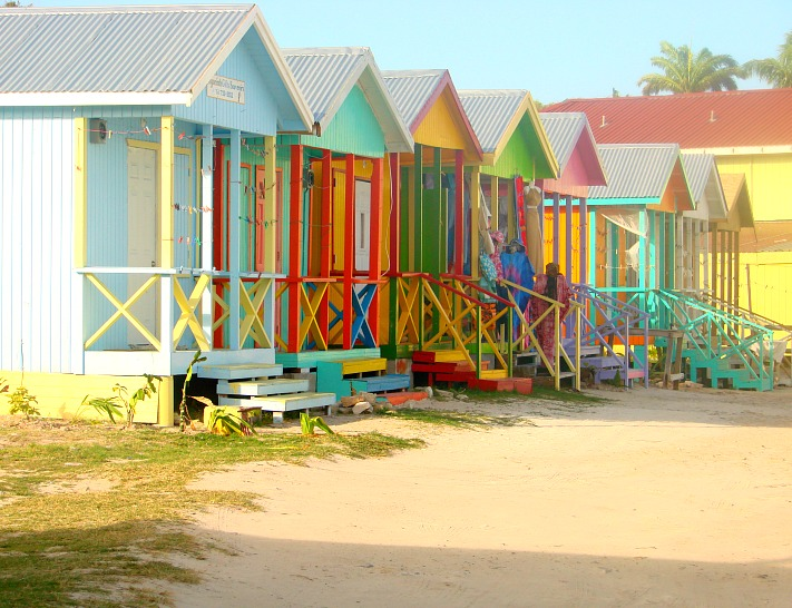 Colourful huts line the beach in Antigua.