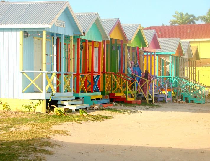 Colourful huts line the beach in Antigua.