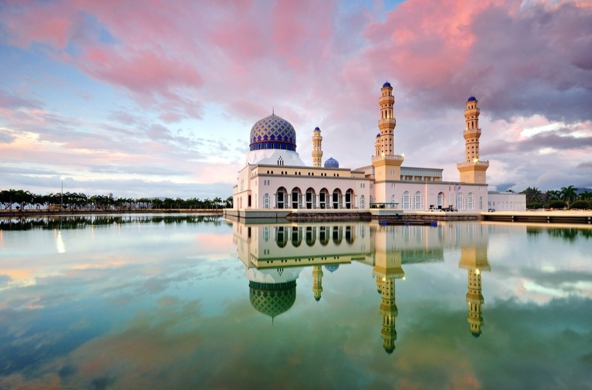Reflection of Kota Kinabalu city mosque during sunset. Kota Kinabalu City Floating Mosque is a famous place of interest in Sabah Borneo, Malaysia.