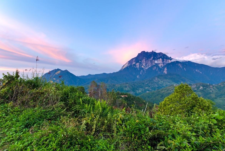 Sunset light over Mount Kinabalu in Kinabalu National Park, Sabah Borneo, Malaysia.