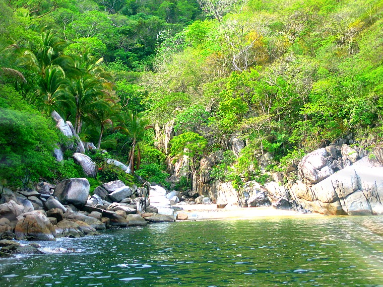 Visiting a beach and cove is one of the fun things to do in Puerto Vallarta, Mexico
