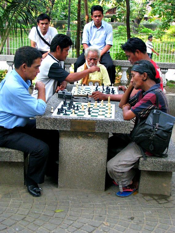 Men play chess in Rizal Park, Manila. philippines
