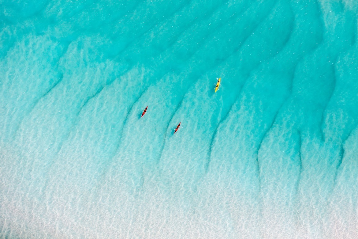 Kayakers at Whitehaven Beach in Australia