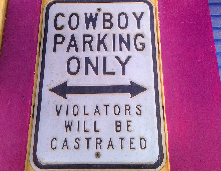 Canada-Yukon-Dawson-City-Cowboy-Sign