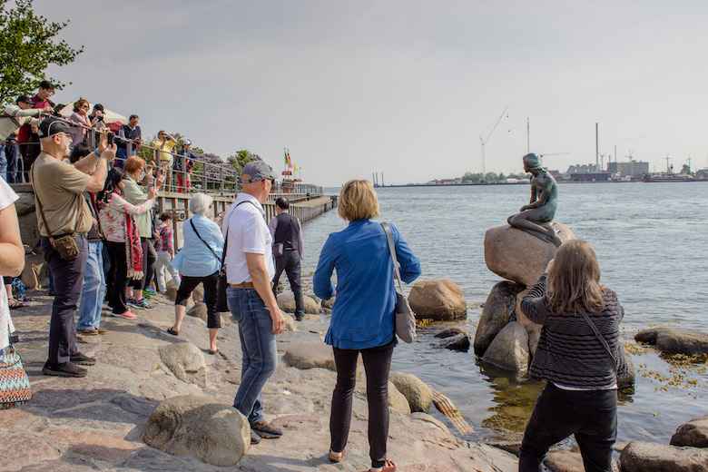 Crowds at the Little Mermaid statue in Copenhagen, Denmark