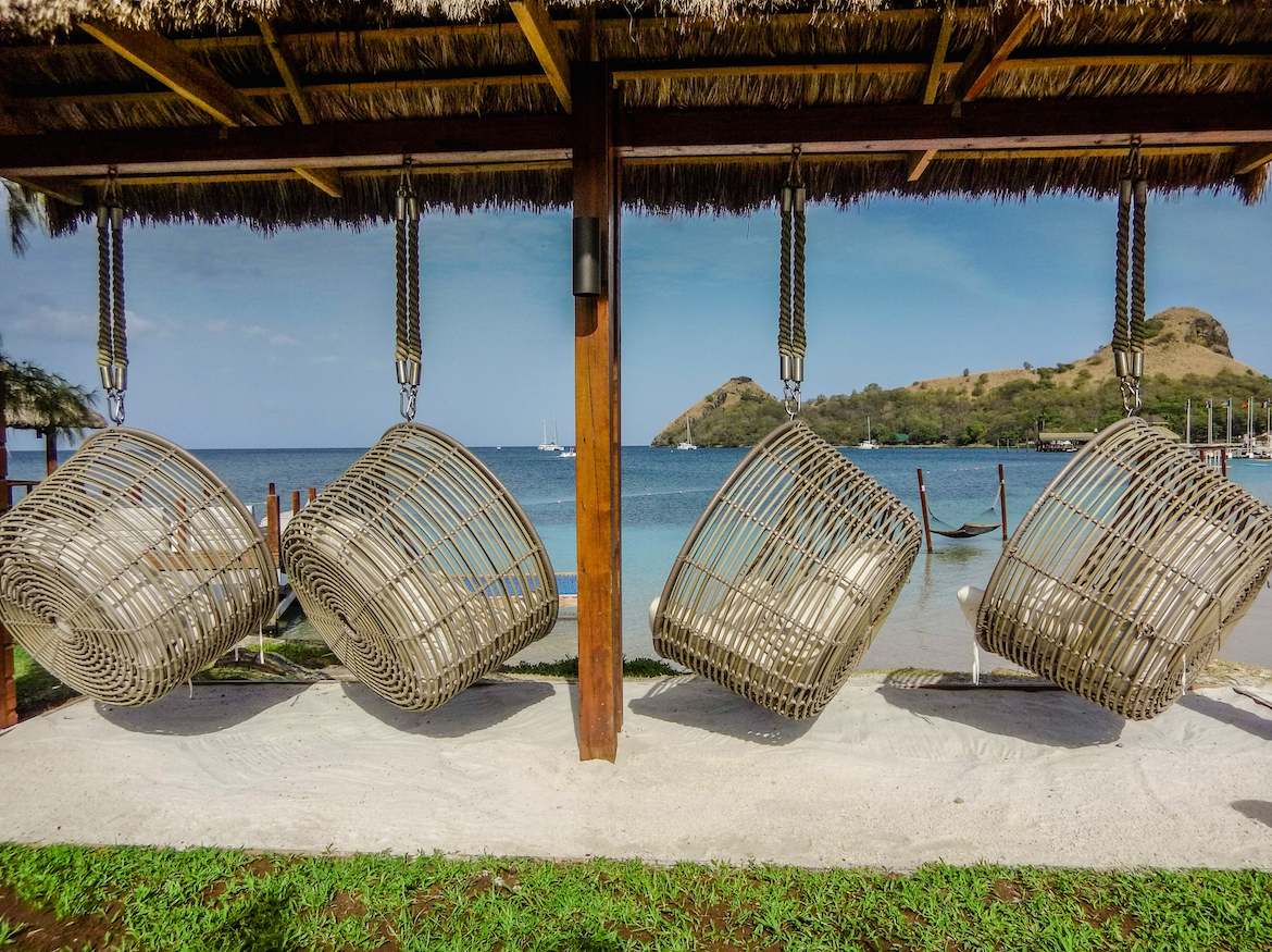 Comfy chairs on the beach at Sandals Grande St. Lucian