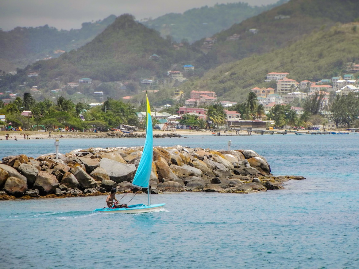 A man sails a boat in Rodney Bay, St Lucia