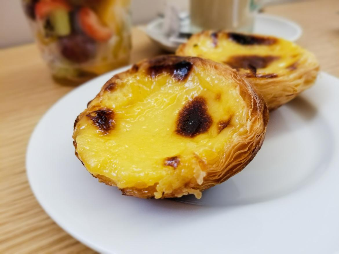 Eating pastel de nata is a must do on a Lisbon itinerary