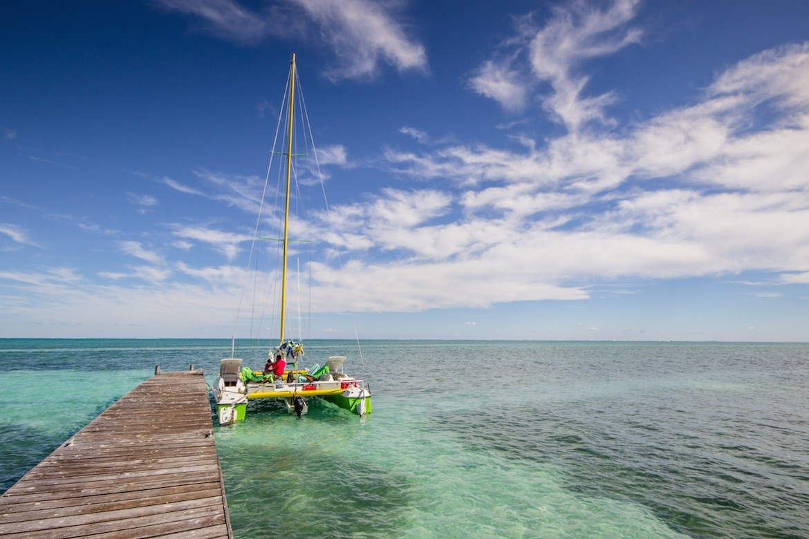 a boat anchored in Caye Caulker, Belize