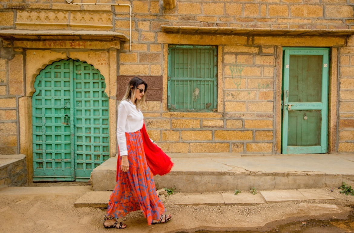 What to wear in India: woman walking in Jaisalmer