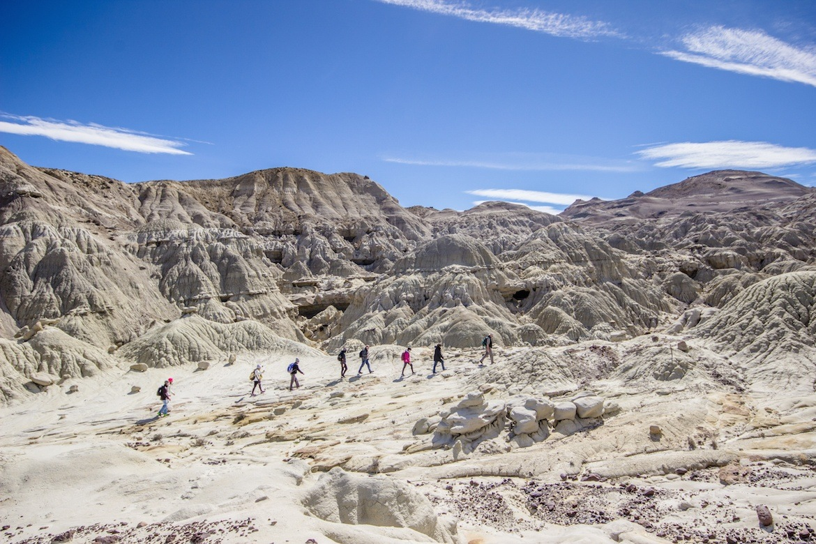 Hikers in a petrified forest in Patagonia, Argentina
