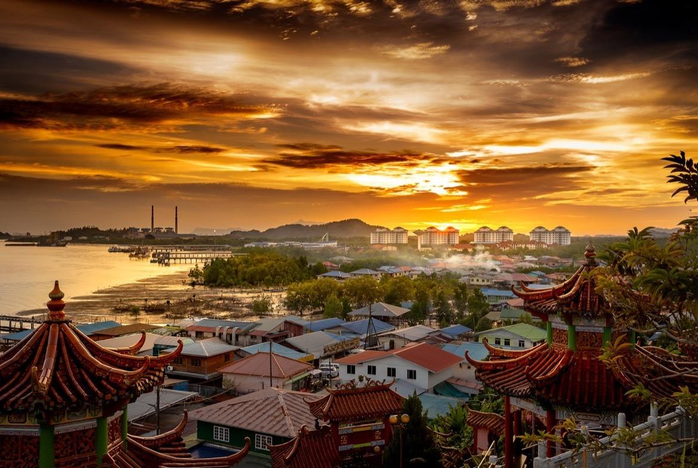 Sunset over the town of Kuching, Sarawak, Malaysia. The best things to do in Kuching, Borneo