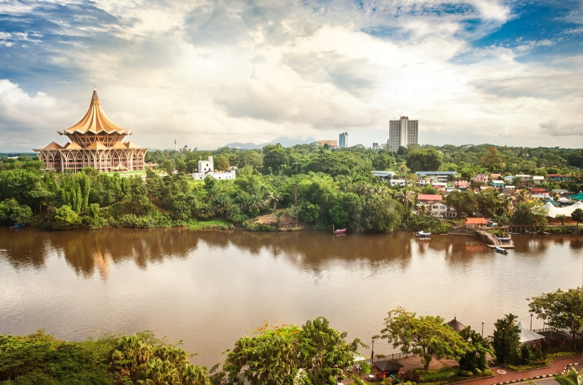 View over the Sarawak River to the north side of the city of Kuching with DUN complex (seat of the Parliament of the Malaysian state of Sarawak) and Fort Margherita, Borneo. Things to do in Kuching, Borneo, Malaysia